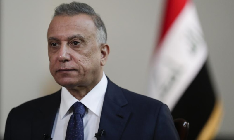 Iraqi Prime Minister Mustafa al-Kadhimi poses in his office during an interview with The Associated Press in Baghdad, Iraq, July 23. — AP