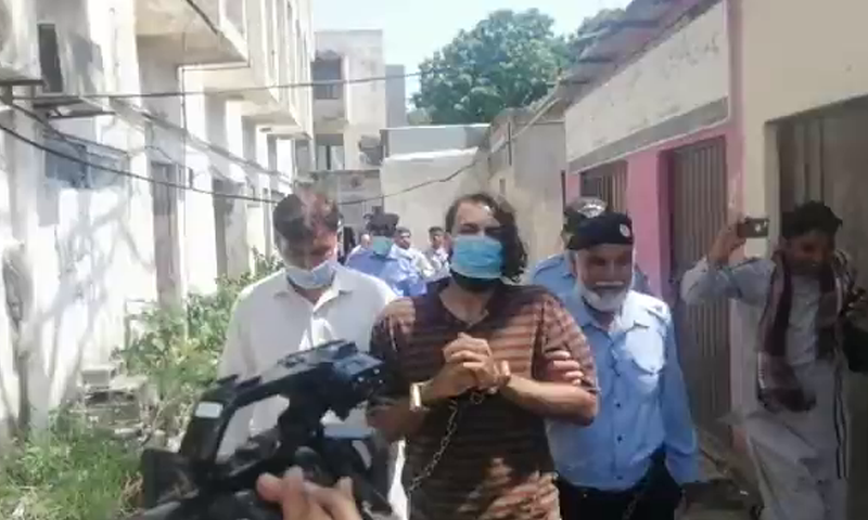 Police escort Zahir Zakir Jaffer, the key suspect in the Noor Mukadam murder case, to the court to seek extension in his physical remand on Friday. — Screengrab via Twitter
