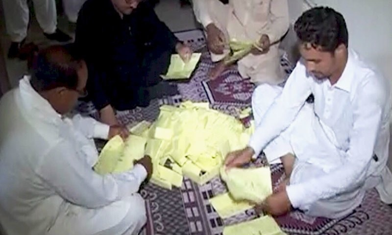 Officials count the votes after polling ended in the AJK elections on Sunday. — DawnNewsTV
