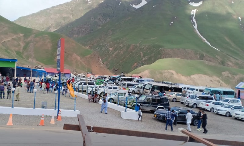 Vehicles carrying tourists are parked at a stop in Kaghan valley. — Photo provided by author