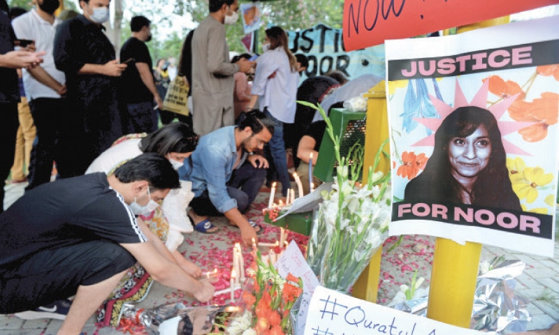 People light candles during a vigil held in memory of Noor Mukadam at Swiss Avenue Park, F-7/4, in Islamabad on Sunday. — Photo by Mohammad Asim