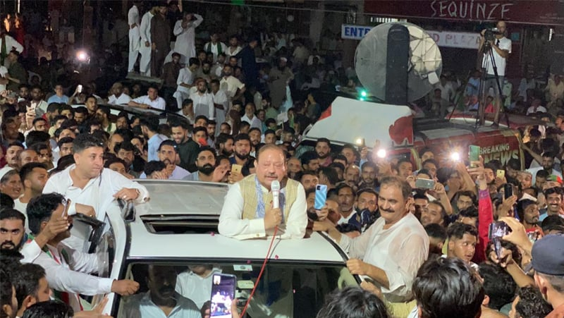 MIRPUR: PTI's regional president Barrister Sultan Mahmood speaks to jubilant party workers after unofficial results confirmed his success in the elections.—Dawn