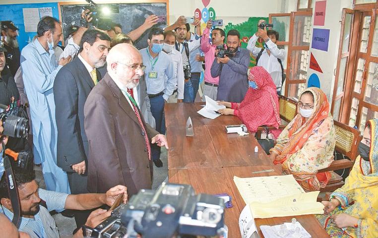 MUZAFFARABAD: Chief Election Commissioner retired Justice Abdur Rasheed visits a polling station on Sunday.—Online