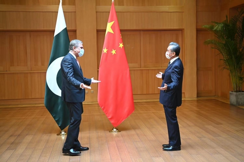 Foreign Minister Shah Mahmood Qureshi (left) meets his Chinese counterpart Wang Yi during a two-day visit to China. — Photo courtesy Twitter