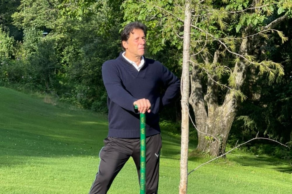 In this photo, Prime Minister Imran Khan plants pine trees in Nathia as part of monsoon plantation campaign. — Photo courtesy PMO Twitter
