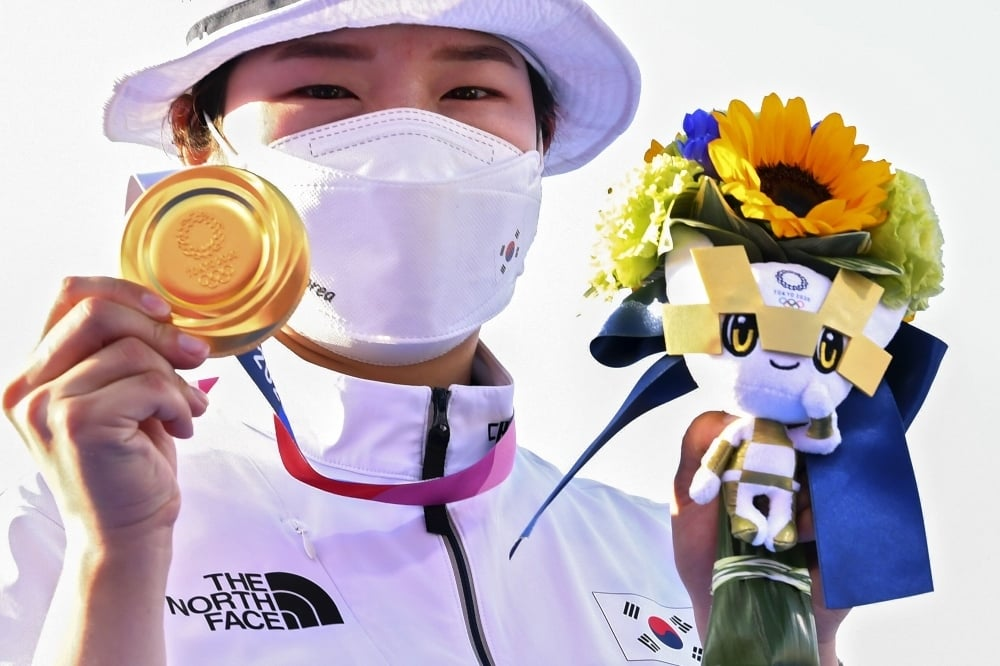 Gold medallist Kang Chae Young of South Korea celebrates with Tokyo 2020 Olympic mascot Miraitowa. — Reuters