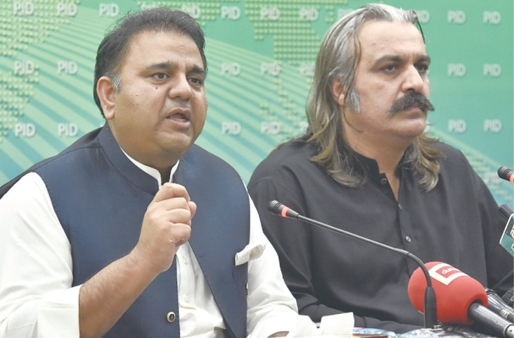 Information Minister Chaudhry Fawad Hussain and Kashmir Affairs Minister Ali Amin Gandapur addressing a press conference on Monday.—Tanveer Shahzad / White Star