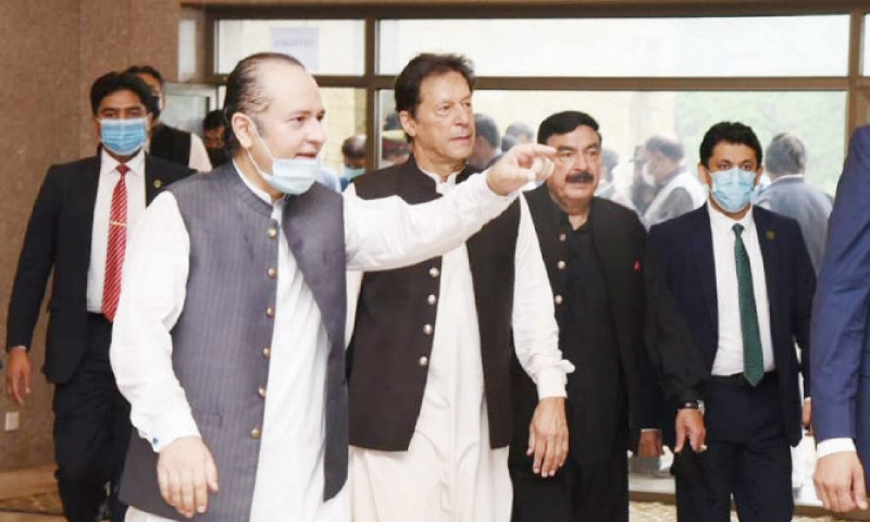An official gestures as he escorts Prime Minister Imran Khan to the Citizen Club in F-9 Park on Monday. — White Star