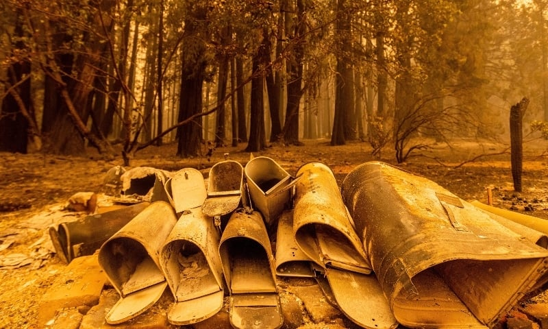 Scorched mailboxes lie on the ground after the Dixie Fire passed through the Indian Falls community of Plumas County on July 25. — AP