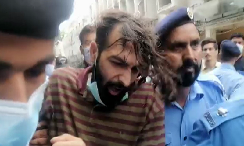 Suspect Zahir Zakir Jaffer (pictured) is being brought to the court for the hearing of Noor Mukadam's brutal murder case. —DawnNewsTV/File