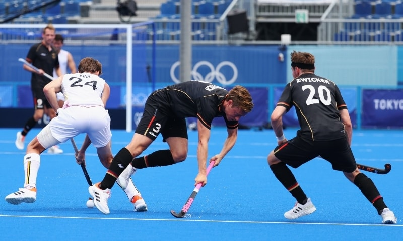 Mats Grambusch of Germany and Martin Zwicker of Germany in action against Antoine Kina of Belgium. — Reuters