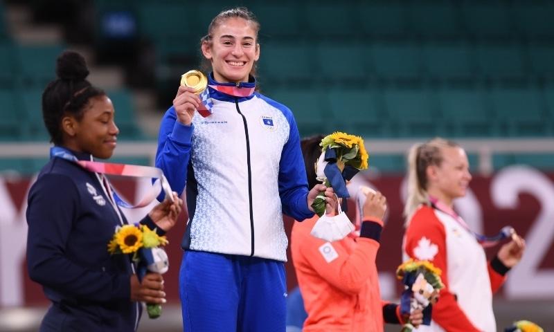 Gold medallist Nora Gjakova of Kosovo celebrates with silver medallist Sarah Leonie Cysique of France, bronze medallist Jessica Klimkait of Canada, and bronze medallist Tsukasa Yoshida of Japan. — Reuters
