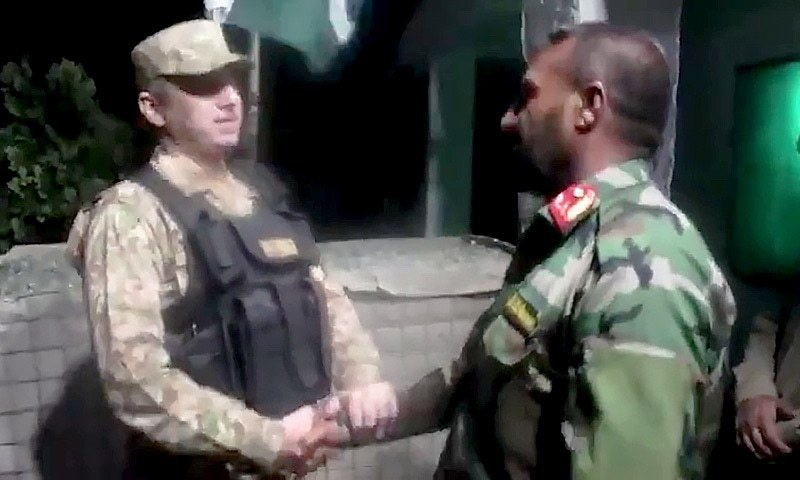 A Pakistan Army officer shakes hands with an Afghan soldier, who is a part of the group of 46 given refuge in Pakistan. — Screenshot courtesy ISPR