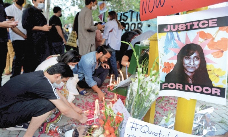 People light candles during a vigil held in memory of Noor Mukadam at Swiss Avenue Park, F-7/4, in Islamabad on Sunday. — Photo by Mohammad Asim/File