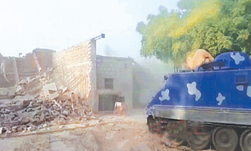 AN armoured personnel carrier advancing into the battlefield cleared by bulldozers.—Dawn