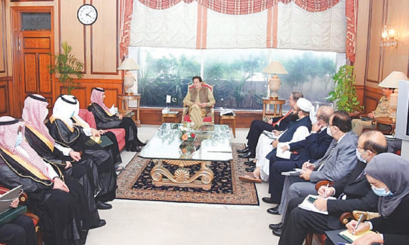 ISLAMABAD: Prime Minister Imran Khan is all smiles as he talks to members of a Saudi delegation led by Foreign Minister Faisal Bin Farhan  Al Saud that called on him on Tuesday.—Online