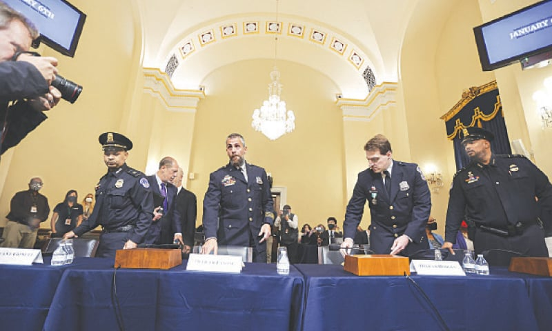 (From left) Sergeant Aquilino Gonell, police officers  Michael Fanone and Daniel Hodges, and sergeant Harry Dunn prepare to testify at the hearing.—AP