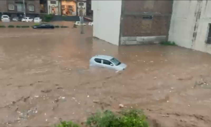 This picture shows a submerged car after Islamabad experienced urban flooding on Wednesday. — DawnNewsTV