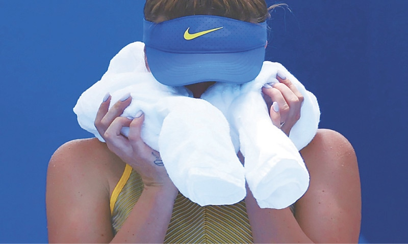 ELINA Svitolina of Ukraine cools off during her tennis quarter-final against Italy's Camila Giorgi at the Ariake Tennis Park on Wednesday.—Reuters