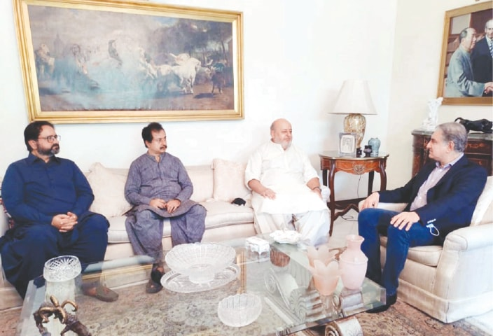 FOREIGN Minister Shah Mahmood Qureshi condoles with Ameer Bakhsh Bhutto over the death of his father Mumtaz Bhutto at the latter's residence in the city on Wednesday.—PPI