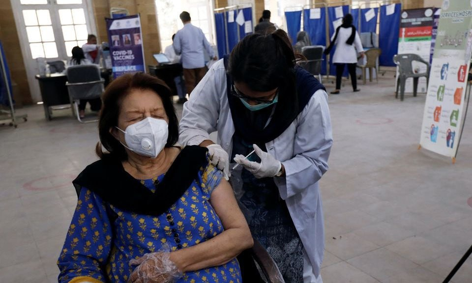 A woman receives the first dose of the coronavirus vaccine at a vaccination centre in Karachi. — Reuters/File