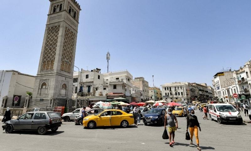 People walk past the Sidi Bashir mosque in the Bab el-Fellah area of Tunisia's capital Tunis on July 28. — AFP