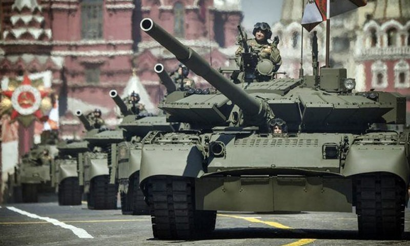In this file photo, Russian tanks stationed at Moscow's base in Tajikistan arrive at training grounds near the border with Afghanistan ahead of army drills. — AFP/File