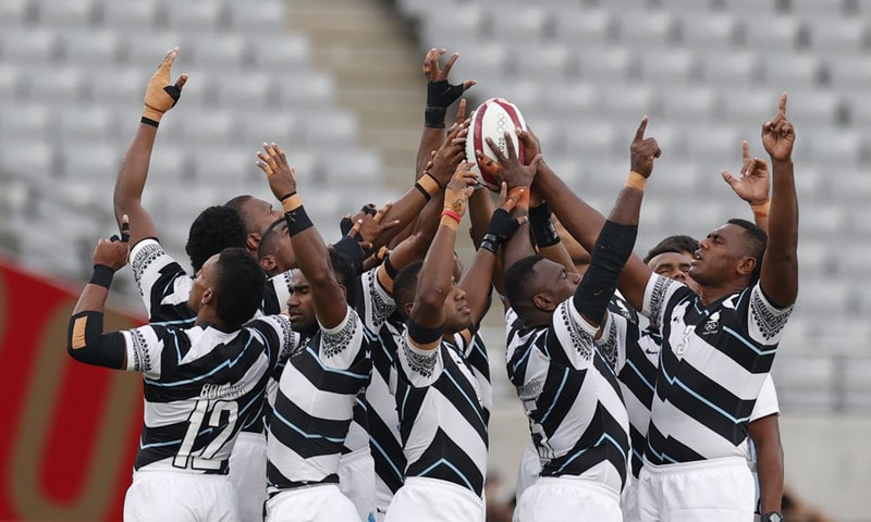 Fiji rugby players pray before the match. — Reuters