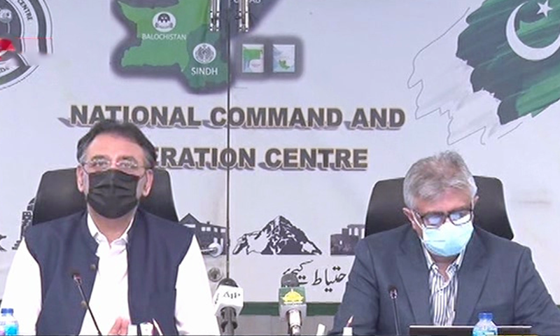 Special Assistant to the Prime Minister on Health Dr Faisal Sultan (right) and Minister for Planning, Development and Special Initiatives Asad Umar speak to the media in Islamabad. — DawnNewsTV