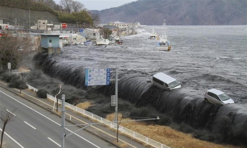 A wave approaches Miyako City in Japan from the Heigawa estuary in Iwate Prefecture after the magnitude 8.9 earthquake struck the area, March 11, 2011. — Reuters/File