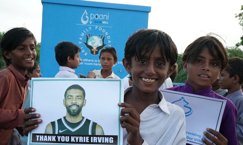 A villagers hold NBA star Kyrie Irving's photograph, that says 'Thank you Kyrie Irving'. — Photo courtesy  Paani Twitter