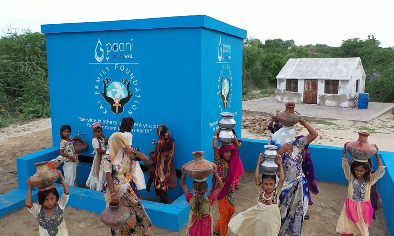 Villagers fill containers with water at the  solar water centre, jointly built by the Paani and KAI Family Foundation. — Photo courtesy  Paani Twitter