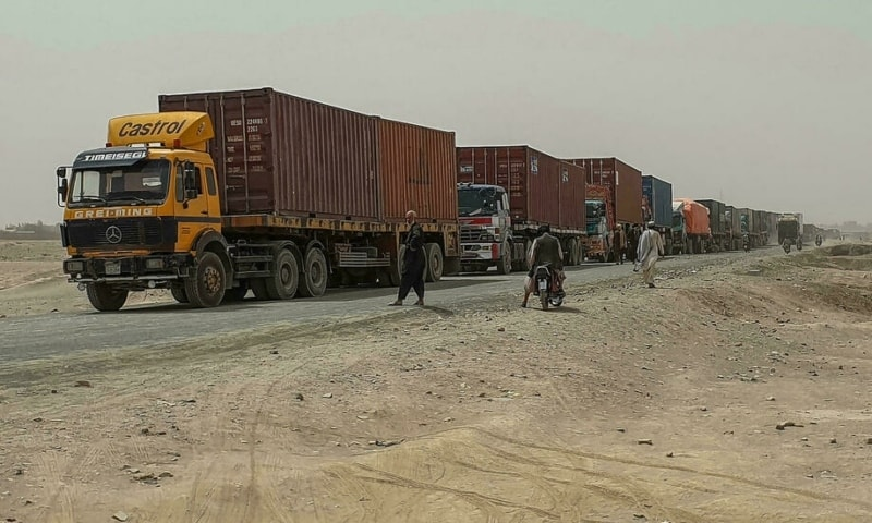 Drivers of Pakistani goods trucks wait along a street leading towards the Afghan border crossing point in Chaman on July 28. — AFP