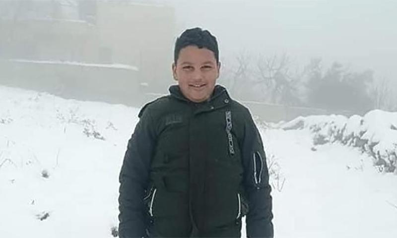 12سالہ فلسطینی بچے محمد الامی کی گزشتہ سال لی گئی ایک یادگار تصویر— فوٹو: رائٹرز