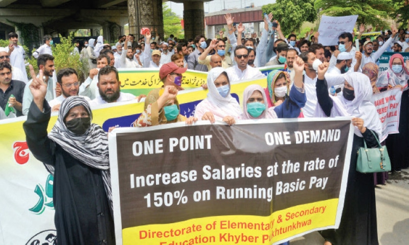 Employees of various directorates stage a demonstration outside the KP Assembly's building in Peshawar on Thursday. — White Star