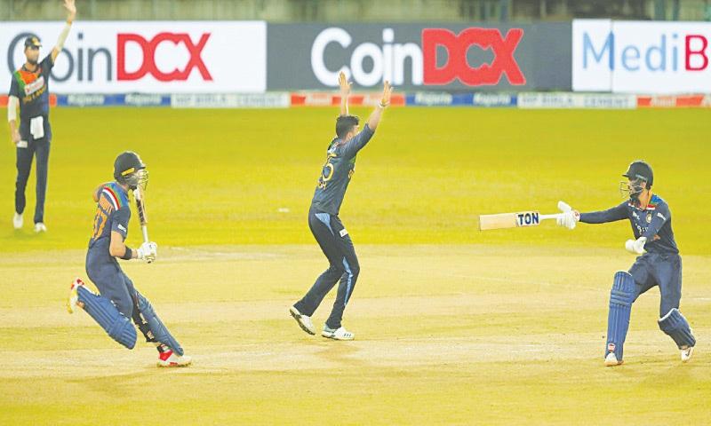 COLOMBO: India's Ruturaj Gaikwad (R) gestures his opening partner Devdutt Padikkal to turn back as Sri Lanka's Wanindu Hasaranga makes an unsuccessful appeal during the third Twenty20 International at the R. Premadasa Stadium on Thursday.—AP