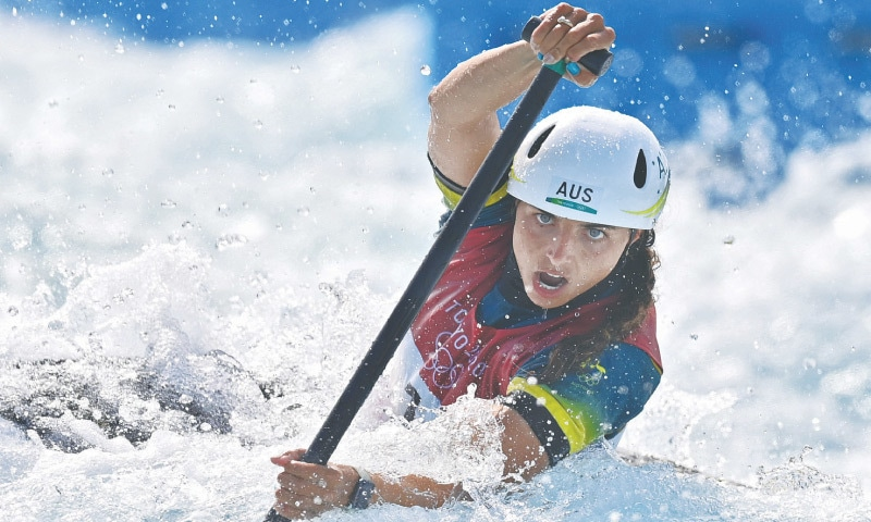 AUSTRALIA'S Jessica Fox competes in the women's C1 at the Kasai Canoe Slalom Centre on Thursday. For years, Fox — regarded as perhaps the greatest paddler of all time with 10 world titles — was among those pushing to get women's canoe slalom accepted as an Olympic sport. With a history-making gold medal within her reach, she was not going to miss her chance. Starting last with an eye on the time she had to beat, Fox shot out of the gate on Thursday and ripped through the rapids to victory in 105.04 seconds, beating friend and rival Mallory Franklin of Britain by more than three seconds for the
