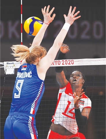 SERBIA'S Brankica Mihajlovic attempts to block a smash from Mercy Sukuku of Kenya during their Pool 'A' match at the Ariake Arena.—Reuters