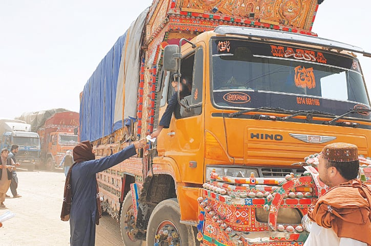 A July 27 picture shows goods trucks preparing to make their way towards the Afghan border crossing point in Chaman.—AFP