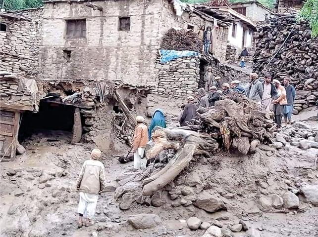 Homes damaged by floodwaters in Bunerdas area of Diamer district, Gilgit-Baltistan.—Dawn
