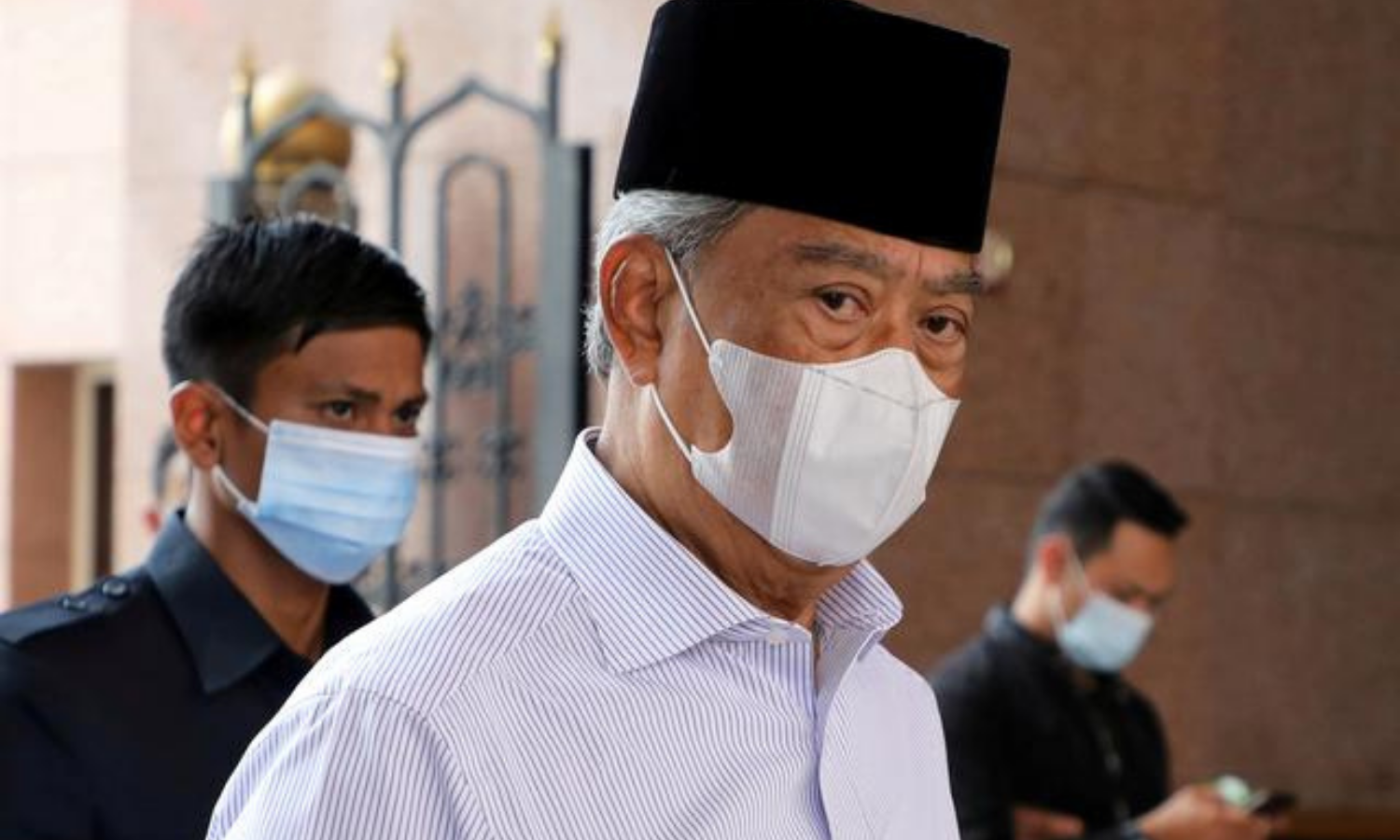 In this file photo, Malaysia's Prime Minister Muhyiddin Yassin wearing a protective mask arrives at a mosque for prayers, amid the coronavirus  outbreak in Putrajaya, Malaysia. — Reuters/File
