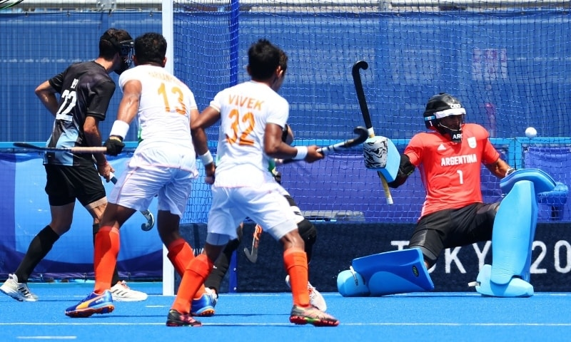 Harmanpreet Singh of India shoots to score past Juan Manuel Vivaldi of Argentina. — Reuters