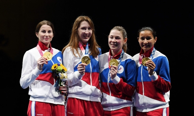 Gold medallist Russia fencers team celebrate on podium during the medal ceremony for the women's foil team. — AFP