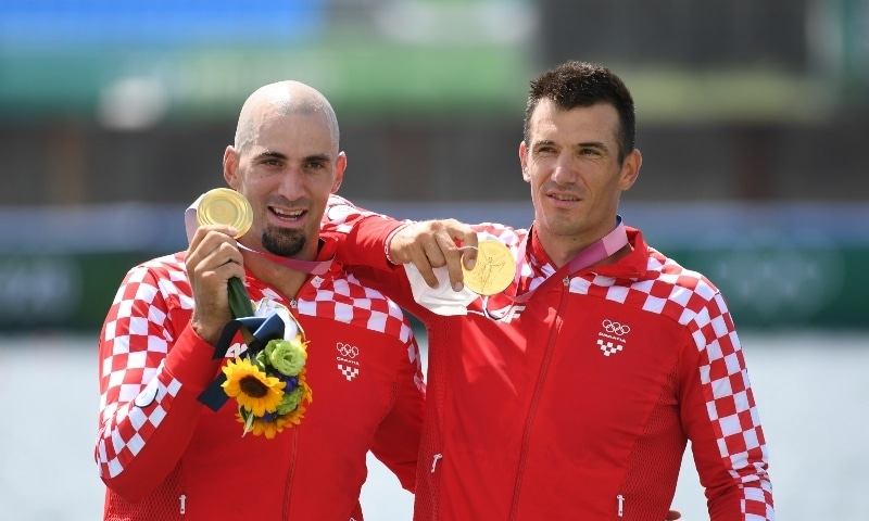 Gold medallists Martin Sinkovic of Croatia and Valent Sinkovic of Croatia celebrate with their medals. — Reuters