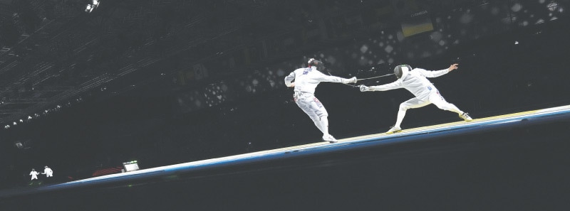 JAPAN'S Masaru Yamada (R) and Kweon Youngjun of South Korea compete in the men's epee team semi-final on Friday.—AP
