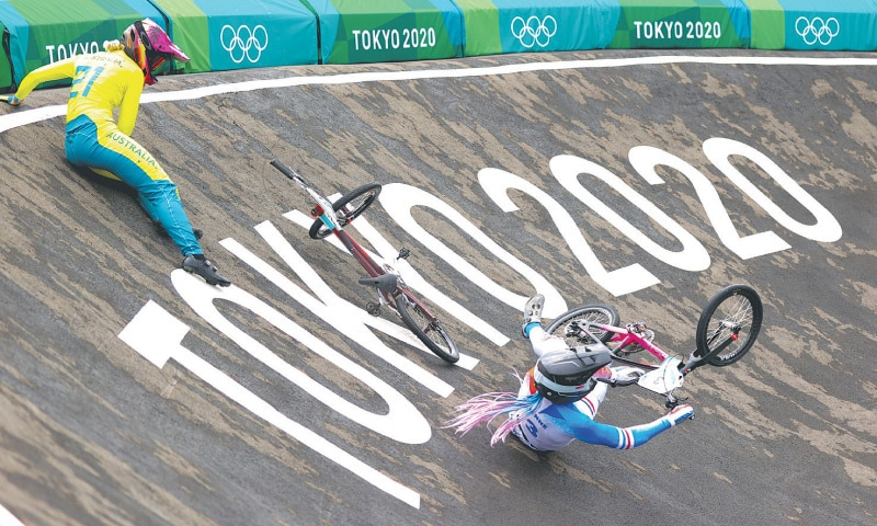 AUSTRALIA'S Lauren Reynolds (L) and Axelle Etienne of France crash during the women's individual BMX racing competition at the Ariake Urban Sports Park on Friday. — Reuters