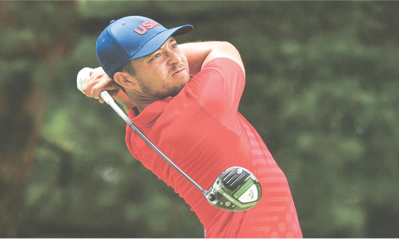 KAWAGOE: Xander Schauffele of the United States watches his drive from the fifth tee in second round of the men's golf individual stroke play at the Kasumigaseki Country Club on Friday. Schauffele shot a sparkling eight-under 63 as he put the United States in the gold medal position before the second round was abandoned for the day due to a late threat of lightning. It left the world number five on 131, a shot clear of Mexico's Carlos Ortiz who had a four-under 67 to follow his first round 65. Play was suspended moments after Schauffele's final putt with 16 players still on the course. That in