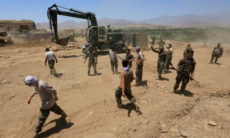 In this file photo, Afghan National Army soldiers are seen rebuilding a checkpoint recaptured from the Taliban, in the Alishing district of Laghman province, Afghanistan. — Reuters