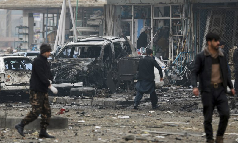 Afghan security personnel inspect the site of a bombing attack in Kabul, Afghanistan. — AP/File
