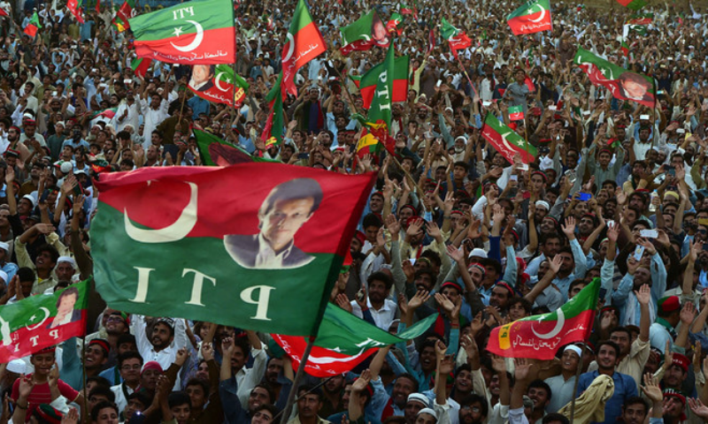 In this file photo, PTI supporters attend a rally in Charsadda. — AFP